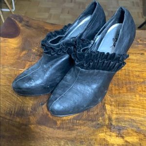 Clearance is black heels with a frill